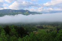 Stock image of dense clouds floating over the hills of the great smoky mountains national park America.