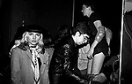 Debbie Harry and Chris Stein of Blondie visit Mark Mothersbaugh of Devo after a concert at The Bottom Line in October 1978