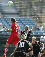 Abby Wambach goes up for the header against Leigh Ann Robinson (7), Leslie Osborne (10) and Rachel Buehler (4). Washington Freedom defeated FC Gold Pride 4-3 at Buck Shaw Stadium in Santa Clara, California on April 26, 2009.