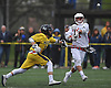 Matthew Benus #21 of Syosset, right, gets off a shot under pressure from Chris Bacotti #14 of Massapequa during a goal in a Nassau County varsity boys lacrosse game at Syosset-Woodbury Community Park on Tuesday, May 3, 2016. Syosset won by a score of 13-12.