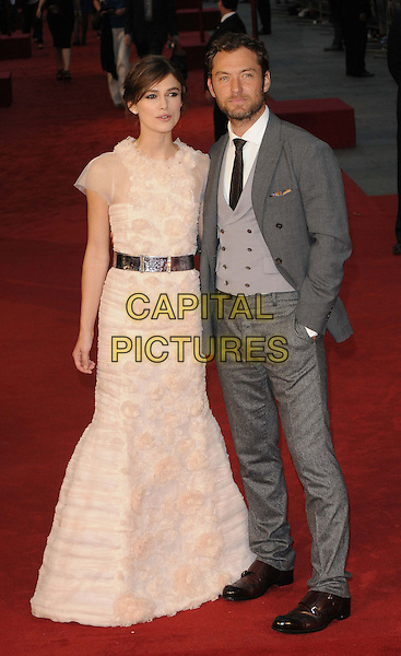 Keira Knightley & Jude Law.The World Premiere of 'Anna Karenina', The Odeon Leicester Square, London, England..4th September 2012.full length peach pink white sheer fluffy ruffle dress silver belt grey gray suit waistcoat beard facial hair hand in pocket .CAP/CAN.©Can Nguyen/Capital Pictures.