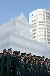 Members of Japan's Ground Self Defense Forces gathers for a group photo in front of one of their creations during the Sapporo Snow and Ice Festival in Sapporo City, northern Japan on Feb 4 2008. The SDF is charged with many of the duties involved in the festival, from trucking in pure white snow to building many of the sculptures on display.