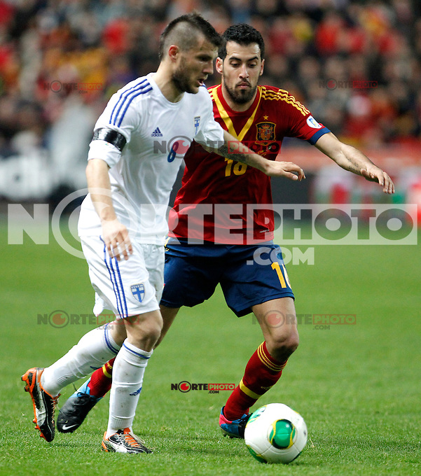 Spain's Sergio Busquets and Hetemaj during international match of the qualifiers for the FIFA World Cup Brazil 2014.March 22,2013.(ALTERPHOTOS/Victor Blanco)