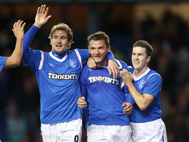 Lee McCulloch celebrates his goal for Rangers with Nikica Jelavic and Matt McKay
