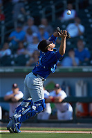 Durham Bulls catcher Nick Ciuffo (9) catches a pop fly during the game against the Charlotte Knights at BB&T BallPark on July 4, 2018 in Charlotte, North Carolina. The Knights defeated the Bulls 4-2.  (Brian Westerholt/Four Seam Images)