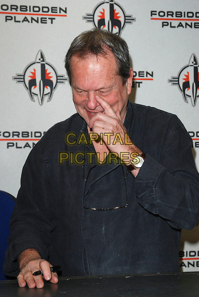 TERRY GILLIAM.Book and DVD Signing at Forbidden Planet, .Shaftesbury Avenue, London, England, .February 3rd 2007..half length hand finger touching nose face itching scratching.CAP/CAN.©Can Nguyen/Capital Pictures