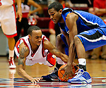 University of Detroit guard Woody Payne dives after a loose ball against Tennessee State in a non-conference matchup at Calihan Hall in Detroit, Michigan on December 8, 2009.  Tennessee State defeated the Titans 70-69.  (Photo by Bob Campbell)