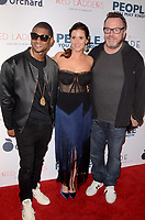 LOS ANGELES, CA - NOVEMBER 13: Usher, Kaily Smith Westbrook and Tom Arnold at People You May Know at The Pacific Theatre at The Grove in Los Angeles, California on November 13, 2017. Credit: David Edwards/MediaPunch