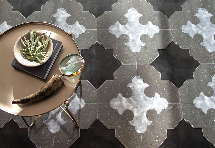 Coronel Grande, a stone waterjet mosaic, shown in honed Orpheus Black and Allure with brushed Basalto, is part of the Miraflores Collection by Paul Schatz for New Ravenna.