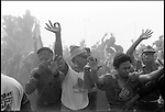Summer '99-- Jakarta, Indonesia -- Megawati fans are blown away by the prop dust of her helicopter after she leaves her final rally before Indonesians vote for a new president. Political life is tough on the world's most inhabited island in the world's biggest muslim nation..