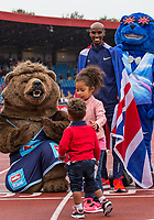 Mo Farah looks on as his son appears to be nervous of the Muller bear Mascot during the Muller Grand Prix Birmingham Athletics at Alexandra Stadium, Birmingham, England on 20 August 2017. Photo by Andy Rowland.