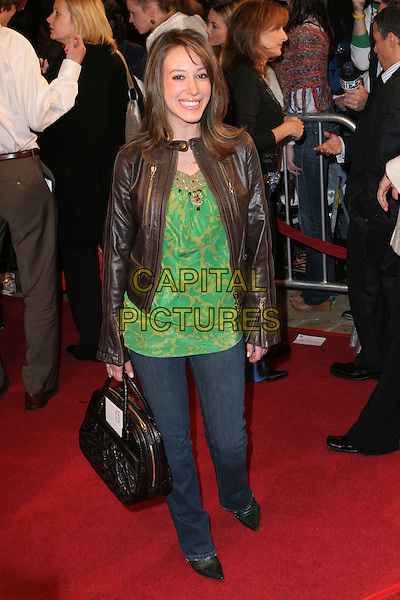 "HAYLIE DUFF.""The Family Stone"" Premiere - Arrivals held at Mann Village Theater, Westwood, California..December 6th, 2005.Photo: Zach Lipp/AdMedia/Capital Pictures.Ref: ZL/ADM.full length green top brown leather jacket bag purse jeans denim.www.capitalpictures.com.sales@capitalpictures.com.© Capital Pictures."