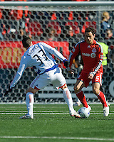 11 April 2009: Toronto FC defender Kevin Harmse #5 tangles with FC Dallas forward Kenny Cooper # 33 during an MLS game at BMO Field in Toronto between FC Dallas and Toronto FC. The game ended in a 1-1 draw.