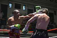 Alec Bishop (red shorts) defeats Rudolf Durica during a Boxing Show at York Hall on 30th June 2018