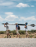 From left, Ramzi Habiby, Tyler Harlow, Mike Foye with Rowan University, carry their rocket to the launch pad at the Spaceport America Cup near the town of Truth or Consequences, New Mexico, Friday, June 23, 2017. The International Intercollegiate Rocket Engineering Competition hosted over 110 teams from colleges and universities in eleven countries. Students launched solid, liquid, and hybrid rockets to target altitudes of 10,000 and 30,000 feet. The 2017 Spaceport America Cup winner was the University of Michigan, Ann Arbor, Team 79.<br /> <br /> Photo by Matt Nager