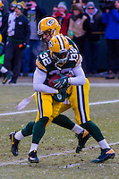 Green Bay Packers running back Christine Michael (32) and quarterback Aaron Rodgers (12) prior to a game against the New York Giants on January 8th, 2017 at Lambeau Field in Green Bay, Wisconsin.  Green Bay defeated New York 38-13. (Brad Krause/Krause Sports Photography)