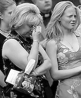 A mom has a tough time making it through the memorial service held Friday April 19, 2002 on the Penn State HUB lawn for the 27 Penn State University students that died during the past year.