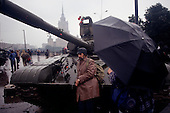 Moscow, Soviet Union<br /> August 21, 1991<br /> <br /> Pro-Yeltsin tanks become more decorative than threatening on the third day of the Soviet coup d'&eacute;tat attempt (August 19-21, 1991), also known as the August Putsch or August Coup. A small group of the Soviet government officials briefly deposed president Mikhail Gorbachev in an attempted to take control of the country. The coup leaders were hard-line members of the Communist Party (CPSU) who felt that Gorbachev's reforms had gone too far in dispersing the central government's power to the republics - better known as perestroika. The coup collapsed in three days, and Gorbachev returned to power, crushing the Soviet leader's hopes that the union could be held together in a decentralized form.