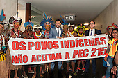 "Indians and sympathetic congressmen hold a banner saying ""The Ondigenous Peoples reject PEC 215"" in Congress during an audience with the Xicrin, Kayapo and Pataxo tribes. Brasilia, Brazil, 10th November 2015. Photo © Sue Cunningham, pictures@scphotographic.com"