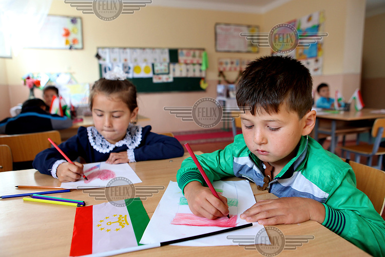 Six year olds Firuz and Malika drawing a Tajik flag at an Early Childhood Education Centre for four to six year olds in Khistevarz Village.