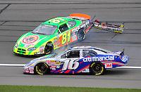 Oct. 3, 2009; Kansas City, KS, USA; NASCAR Nationwide Series driver Greg Biffle (16) goes low as Patrick Sheltra (81) spins during the Kansas Lottery 300 at Kansas Speedway. Mandatory Credit: Mark J. Rebilas-