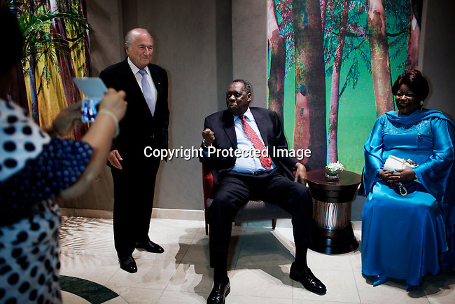 JOHANNESBURG, SOUTH AFRICA - FEBRUARY 9: FIFA president Sepp Blatter poses for pictures with CAF president Issa Hayatou (c) before a dinner in Mr. Blatters honor on February 9, 2013 at Sun international hotel in Sandton, Johannesburg, South Africa. Mr. Blatter visited South Africa to watch the final game of the CAP, Africa's Cup of Nations between Nigeria and Burkina Faso. (Photo by Per-Anders Pettersson)