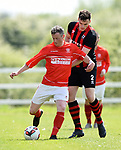 Ronan Mc Cormack of Newmarket Celtic A in action against Terry Lenihan of Bridge United A during their Clare Cup Final at Frank Healy Park. Photograph by John Kelly.