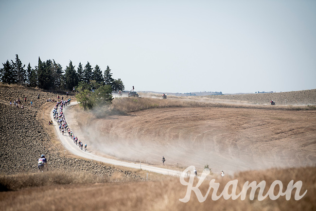 dusty peloton<br /> <br /> 14th Strade Bianche 2020<br /> Siena > Siena: 184km (ITALY)<br /> <br /> delayed 2020 (summer!) edition because of the Covid19 pandemic > 1st post-Covid19 World Tour race after all races worldwide were cancelled in march 2020 by the UCI