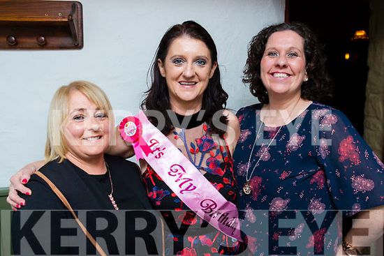Rosaria Davis (centre) celebrates her birthday with friend Anne McGinley and Veronica O'Connell in Betty's Bar on Saturday night last.