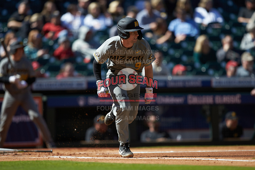 Mark Vierling (9) of the Missouri Tigers hustles down the first base line against the Baylor Bears in game one of the 2020 Shriners Hospitals for Children College Classic at Minute Maid Park on February 28, 2020 in Houston, Texas. The Bears defeated the Tigers 4-2. (Brian Westerholt/Four Seam Images)