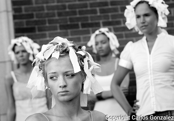 Female models listened to runway instruction with their hair up before a Poolside Fashion Show in Minneapolis, MN.