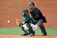 Catcher Ross Steedley #40 of the Charlotte 49ers catches a pitch as home plate umpire Brian Kennedy looks on at Robert and Mariam Hayes Stadium on February 18, 2012 in Charlotte, North Carolina.  Brian Westerholt / Four Seam Images
