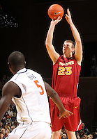 Dec. 30, 2010; Charlottesville, VA, USA; Iowa State Cyclones forward Jamie Vanderbeken (23) shoots over Virginia Cavaliers center Assane Sene (5) during the game at the John Paul Jones Arena. Mandatory Credit: Andrew Shurtleff