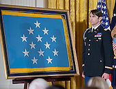 William Swenson, a former active duty Army Captain, who will be awarded the Medal of Honor for conspicuous gallantry, listens as the citation is read in the East Room of the White House in Washington, D.C. on October 14, 2013.  Captain Swenson accepted the Medal of Honor for his courageous actions while serving as an Embedded Trainer and Mentor of the Afghan National Security Forces with Afghan Border Police Mentor Team, 1st Battalion, 32nd Infantry Regiment, 3rd Brigade Combat Team, 10th Mountain Division, during combat operations in Kunar Province, Afghanistan on September 8, 2009.<br /> Credit: Ron Sachs / CNP