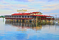 The Santa Maria Restaurant sits on piers above the Matanzas Bay in St. Augustine, Florida. The restaurant is a local tourist attraction advertising you can feed the fish while dining.