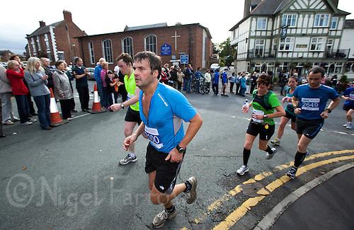 09 SEP 2011 - CHESTER, GBR - Mark McBurnie (Rochdale Harriers) runs through Farndon during the MBNA Chester Marathon .(PHOTO (C) NIGEL FARROW)
