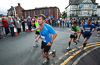 09 SEP 2011 - CHESTER, GBR - Mark McBurnie (Rochdale Harriers) runs through Farndon during the MBNA Chester Marathon .(PHOTO (C) NIGEL FARROW)