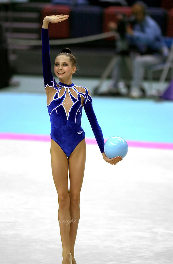 03 OCTOBER 1999 - OSAKA, JAPAN:  Olga Belova of Russia waves to fans after performing with ball in Event Finals at the 1999 World Championships in Osaka, Japan.