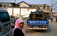CHINA. Beijing. A Muslim woman in a destroyed hutong. 2005