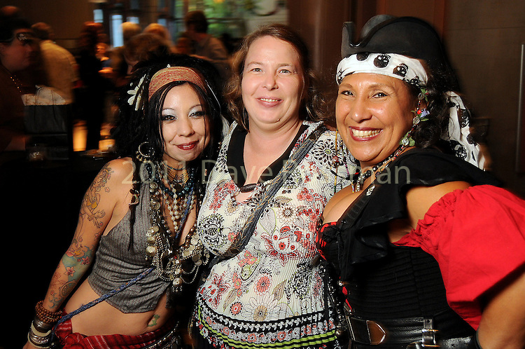 From left: Luna Sissons, Erika Frensley and Cindy Bagwill at a VIP preview of Real Pirates: The Untold Story of the Whydah from Slave Ship to Pirate Ship at the Houston Museum of Natural Science Wednesday Oct. 06, 2010. (Dave Rossman/For the Chronicle)