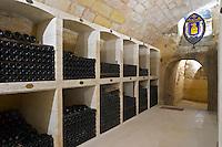 bottles on shelves couvent des jacobins saint emilion bordeaux france