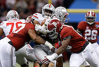 Ohio State Buckeyes running back Ezekiel Elliott (15) gets sandwiched between Alabama Crimson Tide linebackers Reggie Ragland (19) and D.J. Pettway (57) during the second quarter of the Allstate Sugar Bowl college football playoff semifinal at the Mercedes-Benz Superdome in New Orleans on Jan. 1, 2015. (Adam Cairns / The Columbus Dispatch)