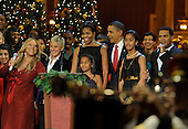 United States President Barack Obama and First Lady Michelle Obama, with daughters Sasha and Malia, take part in the conclusion of a Christmas In Washington celebration, with entertainers (L-R) Mariah Carey, Ellen DeGeneres and Maxwell, at the Building Museum in Washington, DC, USA, Sunday, December 12, 2010.  The event was being taped for later broadcast on TV.   .Credit: Mike Theiler - Pool via CNP
