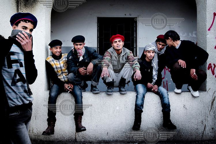 Tobruk is being kept relatively safe and free from looting by groups of armed youngsters who are part of the revolutionary group. In this picture some of them are hanging out in front of the burned out police station. On 17 February the country saw the beginnings of a revolution against the ruling Col Muammar Al Gaddafi. Rebels now seem to control Tobruk after a pivotal attack on the city's police station. In total between 150 and 200 civilians have been killed in violence during the uprising in this area alone.