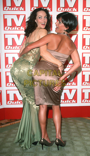 SAMANTHA ROBSON & TRACY SHAW.TV Quick Awards At The Dorchester.Ref: 11041.funny, sticking out bottoms, rear, behind, full length, full-length.www.capitalpictures.com.sales@capitalpictures.com.© Capital Pictures.