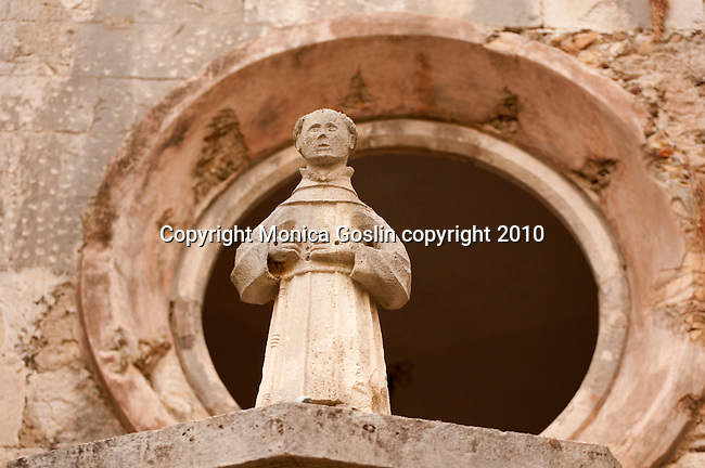 Detail of a sculpture in the courtyard of the Franciscan Monastery and Museum in Dubrovnik, Croatia.