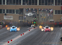 Jul 22, 2018; Morrison, CO, USA; NHRA funny car driver John Force (left) races alongside daughter Courtney Force during the Mile High Nationals at Bandimere Speedway. Mandatory Credit: Mark J. Rebilas-USA TODAY Sports
