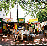 The food carts located in a parking lot on SW Fifth Ave. in downtown Portland, Oregon offer affordable lunchtime meals in a variety of ethnic cuisines.