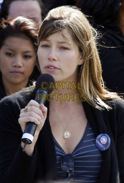 "JESSICA BIEL .""Last Chance for Change"" Rally and Canvas Kick-off with Justin Timberlake held at the Clark County Amphitheater, Las Vegas, Nevada, USA, .11 October 2008.portrait headshot brunette brown hair fringe side swept no make-up gold peace sign necklace microphone speaking .CAP/ADM/MJT.©MJT/Admedia/Capital Pictures"