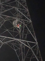 Fire service rescue base jumper stranded 100ft on a pylon
